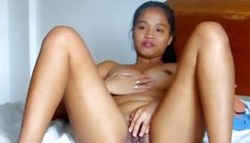 Messy asian whore is fingering her snatch